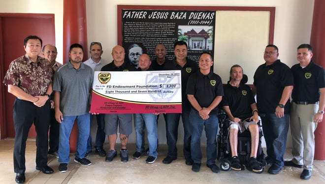 "The Father Duenas Memorial School Class of AD7 (1987) made three donations in December, 2017. The class established The FD Class of AD7 James Tuquero Memorial Scholarship in memory of all classmates who have died. The scholarship was named after Tuquero, whom the class lost in the summer between its sophomore and junior years. The first of the fund's installments, $8,700, was donated to the FD Endowment Foundation whose mission is to financially support FDMS students and faculty development. The scholarship fund will total at $25,000 at completion of installments. The class also donated $1,000 each to FDMS Alumni Association for its activities; and to the school itself for students with financial issues. The primary source of donated funds was the FD Class of AD7 Par Tree Golf Tournament held last year. ""James never had the opportunity to walk with us on graduation day,"" said Tim Leddy, AD7's president. ""We wanted to honor him by naming this scholarship in his memory and for all of our AD7 brothers who have passed."" Pictured from left: Oscar Miyashita, Felix Reyes, John Tuquero, Joe McDonald, Jesse Sablan, Bill Gutierrez, Ferlito Peroy, Tim Leddy, Gus Sablan, Paul Terlaje, Bill Mesa, John Perez."