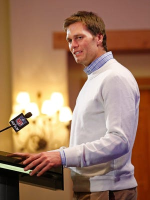"""New England Patriots quarterback Tom Brady talks with the media at the Sheraton Wild Horse Pass Resort & Spa on Jan. 26, 2015 in Chandler.  Brady refused to discuss """"Deflategate""""."""