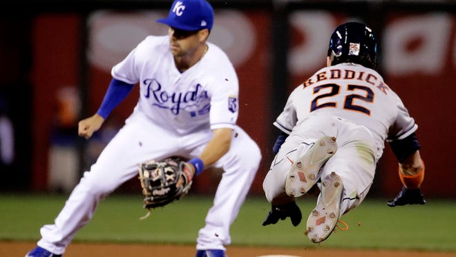 Houston Astros' Josh Reddick (22) beats the tag by Kansas City Royals second baseman Whit Merrifield to steal second during the eighth inning of a baseball game Tuesday, June 6, 2017, in Kansas City, Mo. (AP Photo/Charlie Riedel)