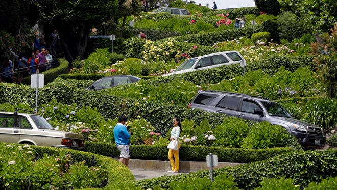 Motorists make their way down Lombard Street on Tuesday.  San Francisco's crooked street could soon be closed to tourists in the summertime.