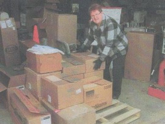 Janice Gilbertson in the WNP Warehouse, unloads items for delivery to the Learning Centers in Nicaragua.