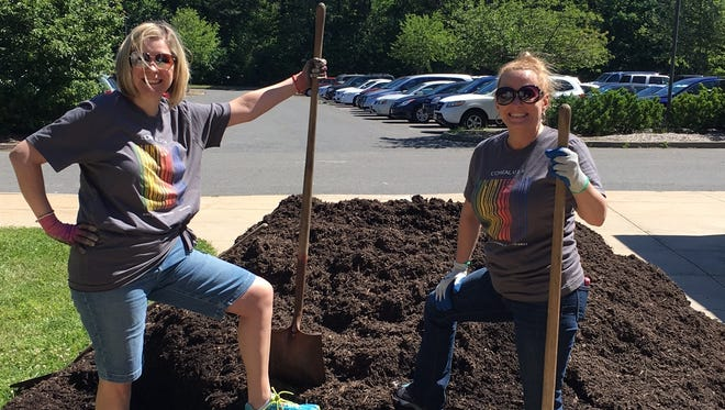 "Sheri Vegso and Sue McCloskey were two of the seven volunteers from L'Oréal Cranbury who helped out at the Academy Learning Center as part of the international cosmetic firms ""Give Back"" day."