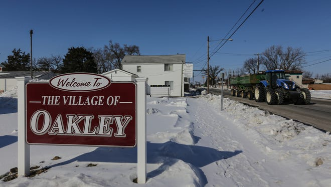 Traffic moves along Main Street in the village of Oakley on Monday, March 2, 2015.