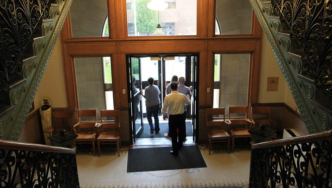 People exit the Johnson County courthouse on Friday, Sept. 18, 2015.