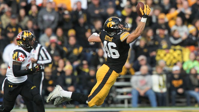 Iowa's George Kittle pulls in a deep pass during the Hawkeyes' game against Maryland at Kinnick Stadium on Saturday, Oct. 31, 2015.