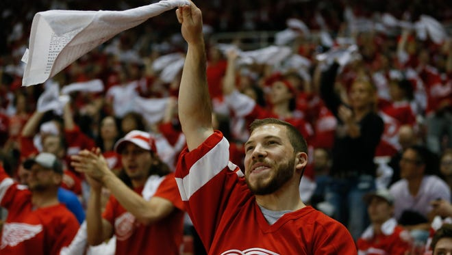 A Red Wings fan cheers on his team against Tampa Bay during the third period of Game 3 of the NHL playoffs between the Detroit Red Wings and the Tampa Bay Lightning at Joe Louis Arena in Detroit on Sunday, April 17, 2016.