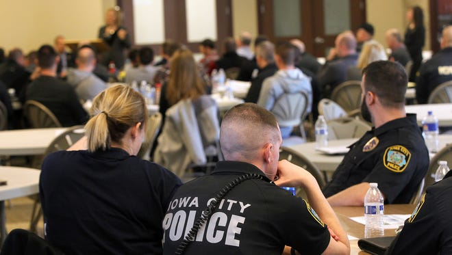 Iowa City Police officers sit at a table during a Crisis Intervention Team training event at Saint Patrick's Church on Monday, March 20, 2017.