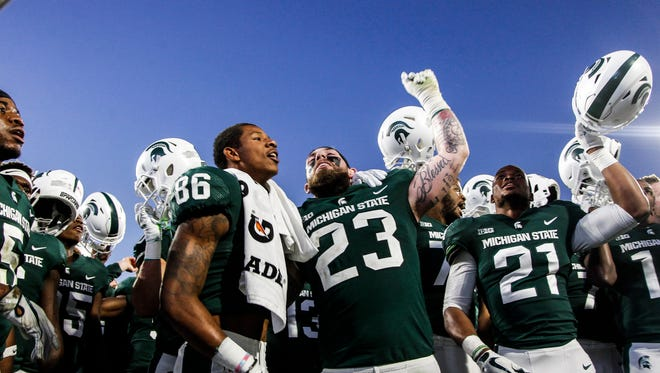 The Spartan football team sings the Fight Song Saturday, Sept. 30, 2017, after beating Iowa 17-10 at Spartan Stadium in East Lansing.