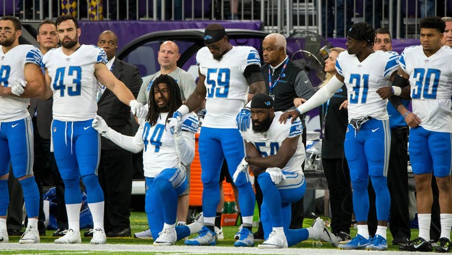 Oct 1, 2017; Minneapolis, MN, USA; Lions linebackers Jalen Reeves-Maybin (44) and Steve Longa (54) kneel during the national anthem before the game against the Vikings at U.S. Bank Stadium.