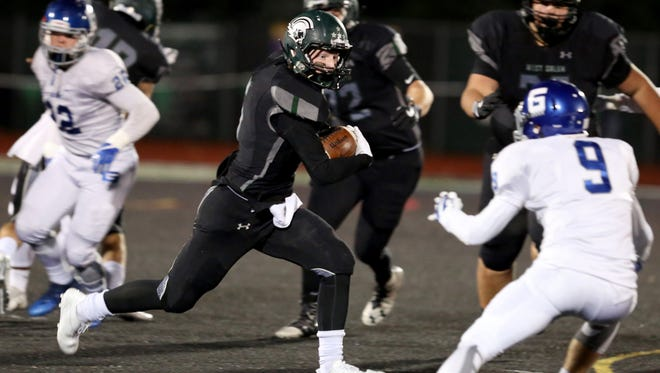West Salem's Jacob Denning (5) rushes in the Grant vs. West Salem football game in the second round of the OSAA Class 6A playoffs at West Salem High School on Friday, Nov. 10, 2017.