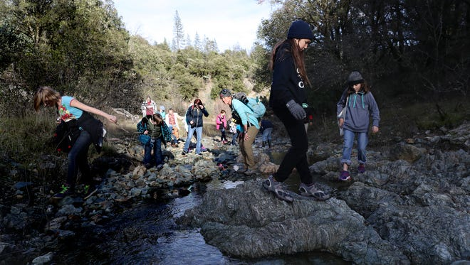 File photo - Kathy Hill, a field instructor at Whiskeytown Environmental School, center, on Monday, Jan. 29, 2018 leads a group of fifth-graders on a hike.