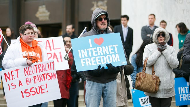 People gather on the steps on the Oregon State Captiol for a net neutrality rally on Friday, Feb. 23, 2018. In December, the Federal Communications Commission voted to repeal net neutrality, which would decrease regulation on cable companies and could lead to increased rates for consumers.
