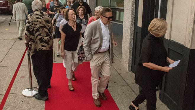 "Moviegoers walk the red carpet into the premiere of the ""The House with a Clock in its Walls"" at the Bogar Theater in Marshall Thursday evening."