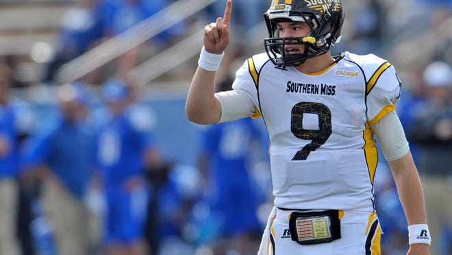 Southern Miss quarterback Nick Mullens signals from the line against Middle Tennessee on Saturday.