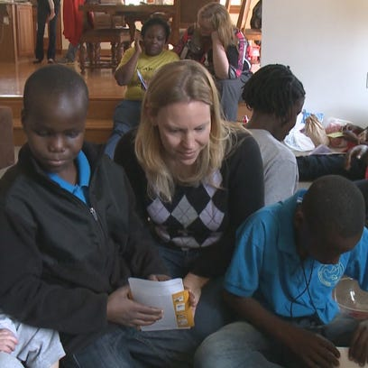 Local doctor opens home to African Children's Choir