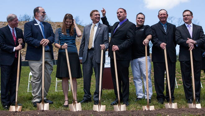 From left to right, Del. Steve Landes, R-Weyers Cave, Frank Root, founder and president of Countryside Holdings Incorporated, Ashley Spence, a Countryside Holdings Incorporated marketing representative, Sen. Emmett Hanger, R-Mount Solon, Mike Donovan, president of Nexus Services, Erik Schneider, chief risk management officer for Nexus Services, Michael Shull, chairman of the Augusta County Board of Supervisors, and Rick Nagel, director of government affairs for Nexus Services, prepare to shovel a line of dirt as part of a groundbreaking ceremony for Nexus Services at Mill Place Commerce Park in Verona on Tuesday, April 28, 2015.