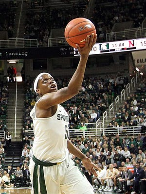 Michigan State's Cassius Winston (5) gets fouled and converts a layup during Sunday's first half, but the freshman missed the ensuing free throw. He was 5 of 9 at the line despite a career-high 21 points as the Spartans lost to Northeastern, 81-73.
