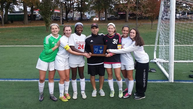 Glen Ridge girls soccer seniors: (from left) Victoria Woznick, Liz Hauschild, Lindsay Jaiyesimi, coach Oscar Viteri, Gabby Sanchez, Daphne Patton and Janet Svetik.