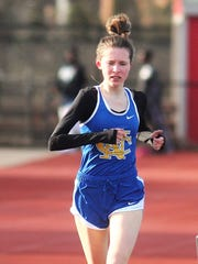Abby Jones of Newport Central Catholic rolls to the win in the 1,600 at the Dixie Heights Gold Medal track and field meet April 5, 2018 at Dixie Heights HS, Edgewood.