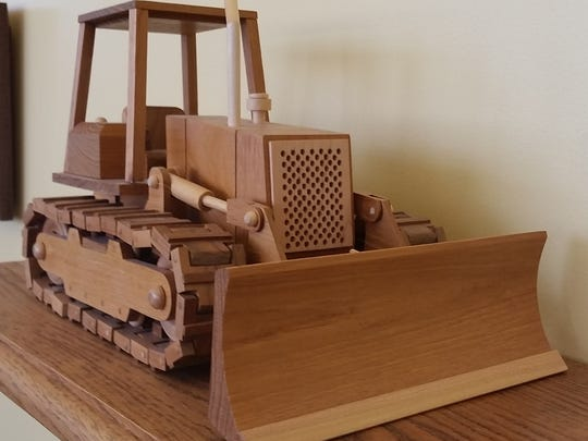 Dan Austad built this wooden model of a bulldozer, on display at the Door County Highway Shop complex on South Duluth Avenue in Sturgeon Bay.
