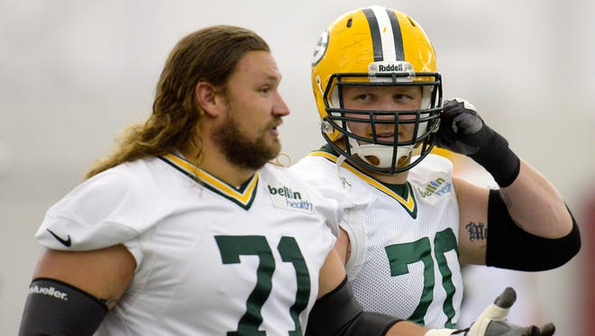 Green Bay Packers offensive linemen Josh Sitton (71) and T.J. Lang (70).