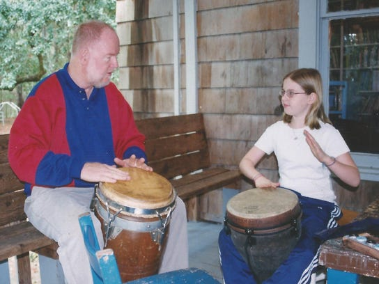 Pat with daughter Hope teaching drums