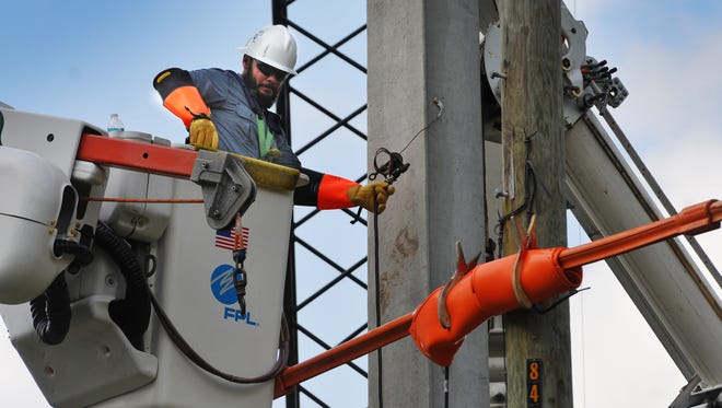 An FPL crew members works to harden the grid in West Melbourne in April 2016.