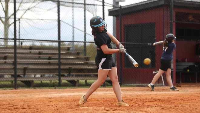 Florida High junior Macy Mizell takes batting practice on Monday. Mizell is hitting .483 for the Seminoles (11-8).