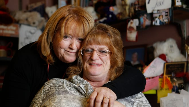 Dixie Sucher (left) is photographed with her daughter, Kelly Chambers. Chambers lost her daughter, Crystal, to AIDS in 1991, and has been living with AIDS herself for 20 years.