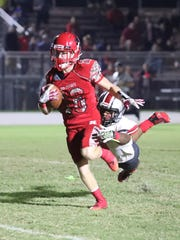 Clayton Savinsky gains yards for North Fort Myers just