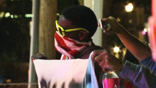 Demonstrators took to the streets again Thursday night in Ferguson.