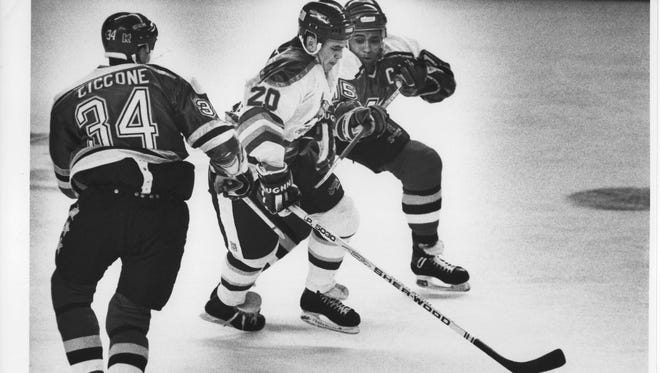 Phoenix Roadrunners' Bill O'Dwyer has the puck in a 1991 game.