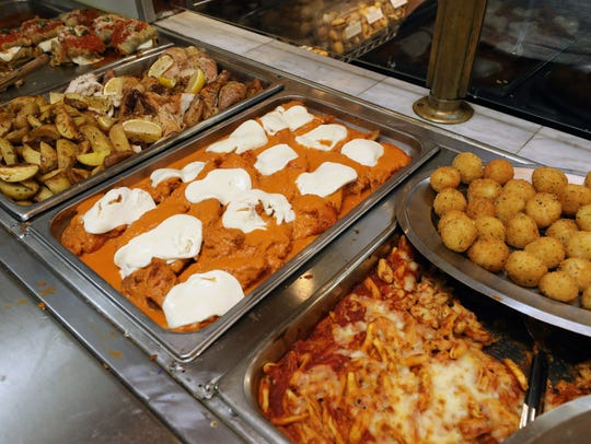 Some of the prepared hot food are pictured at Rossi