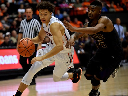 Freshman guard JaQuori McLaughlin (left) is averaging a team-high 17.7 points and 4.0 assists the last three games.