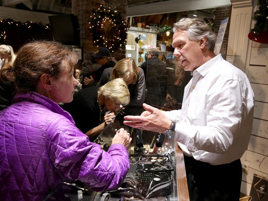 Gary Thrapp helps customers  during the retirement sale at his jewelry store, G. Thrapp Jewelers, at 5609 N. Illinois St.