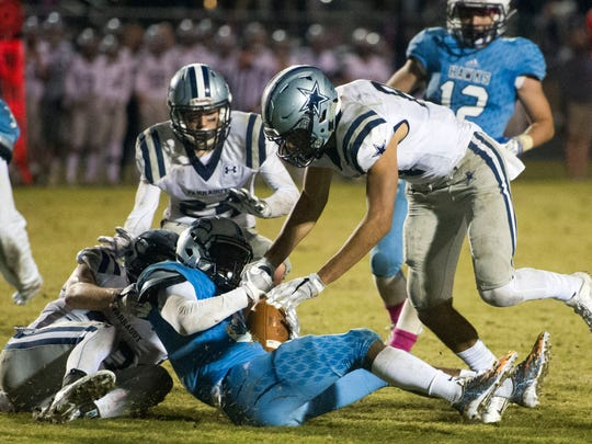 Hardin Valley's Cartez Campbell intercepts the ball on a hail mary pass for secure their 37-36 win over Farragut on Thursday, October 26, 2017.