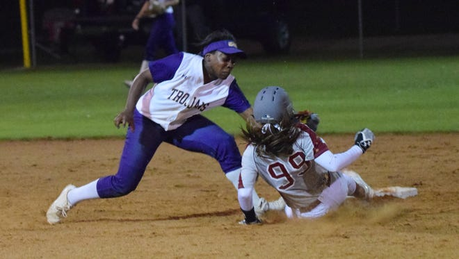 ASH's Taryn Antoine (1, left) tags Pineville's Kacee Mertens (99, right) out at second after Mertens tried to steal second.
