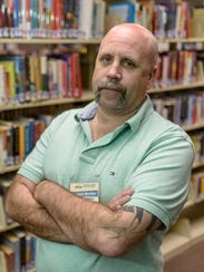 Student worker Jeremy Wells, 46, works the computer