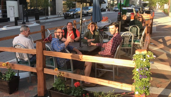 Patrons enjoy the new patio space at the corner of 6th St. and Main St.