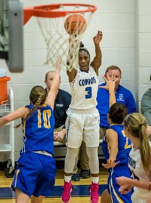 Senior Ashli O'Neal lets fly from the corner for the Cowboys.