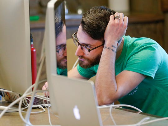 Mat Scott, software engineer at Mostly Serious, works during Give Ozarks on Tuesday, May 9, 2017.