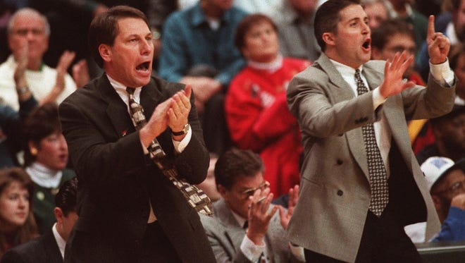 First-year MSU head coach Tom Izzo, left, cheers on his team as assistant Brian Gregory gives instructions on Jan. 20, 1996 against Iowa.
