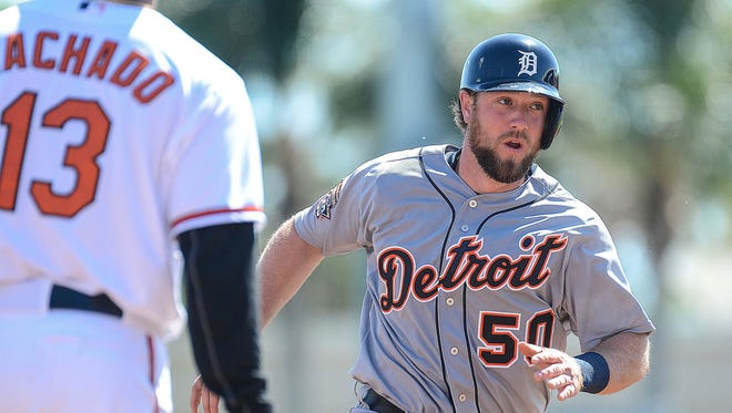 Detroit Tigers catcher Bryan Holiday heads for third base in the second inning today against the Baltimore Orioles at Ed Smith Stadium.