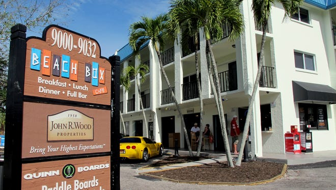 FIL E- Two floors of residential units are above Beach Box Cafe and the other businesses on the corner of Gulf Shore Drive and Vanderbilt Beach Road in North Naples.