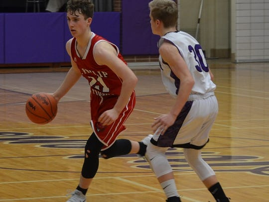 St. Philip guard Conor Gausselin brings the ball upcourt