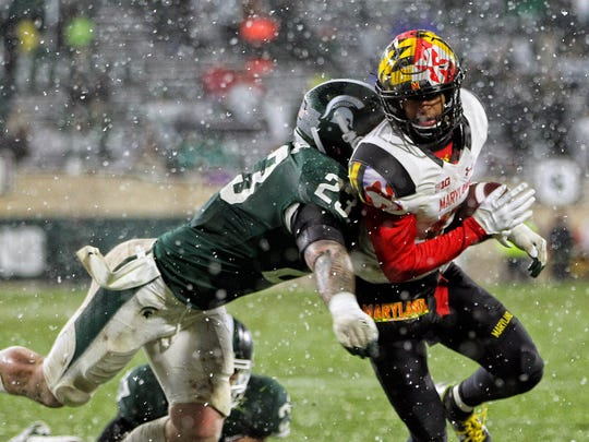 Nov 18, 2017; East Lansing, MI, USA; Maryland Terrapins wide receiver D.J. Moore (1) is tackled by Michigan State Spartans linebacker Chris Frey (23) during the second half of a game at Spartan Stadium. Mandatory Credit: Mike Carter-USA TODAY Sports