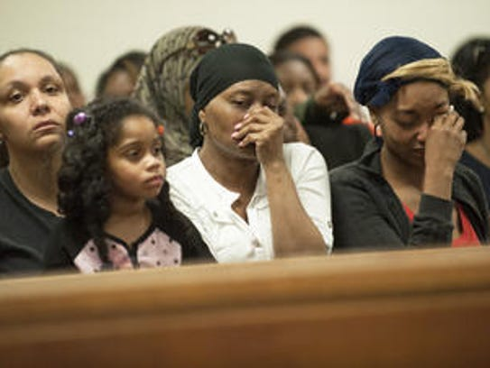 Family members attend a court hearing after the April
