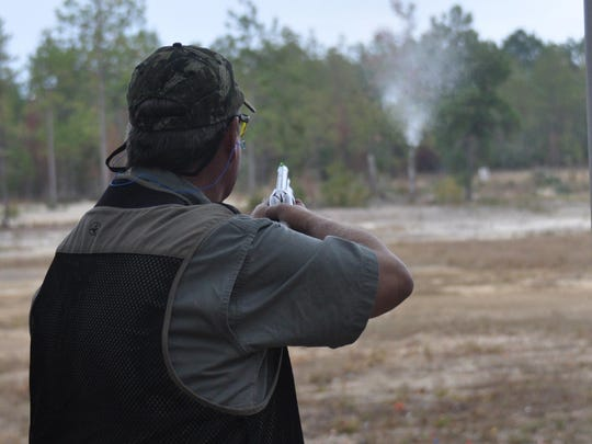A Gulf Power employee shoots a target at the 2014 annual Clay Shoot for America's Heroes designed to support local organizations that provide for the direct needs of active-duty and retired military service members and their families across Northwest Florida.