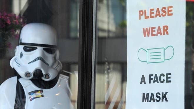 "A ""Star Wars"" stormtrooper keeps an eye on Main Street in Hyannis from his window seat inside Flashbacks. Unlike other tourist hot spots such as Chatham, Provincetown and Nantucket, the town of Barnstable has no plans to establish a mandatory masking zone in downtown Hyannis or elsewhere, said Health Director Thomas McKean."