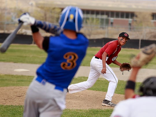Shiprock's Dylan Begay strikes out Bloomfield's Chauncey White in the second inning of their game on Thursday at Shiprock High School in Shiprock.